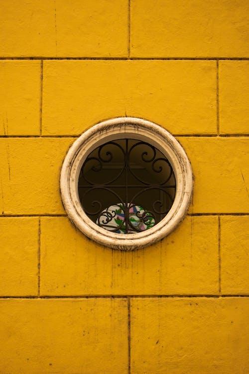 Gratis stockfoto met beton, geel, muur, raam