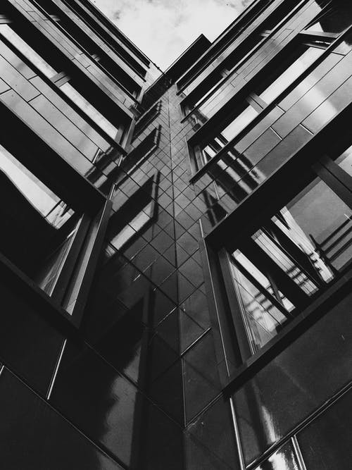 Low Angle Grayscale Photo of Highrise Building