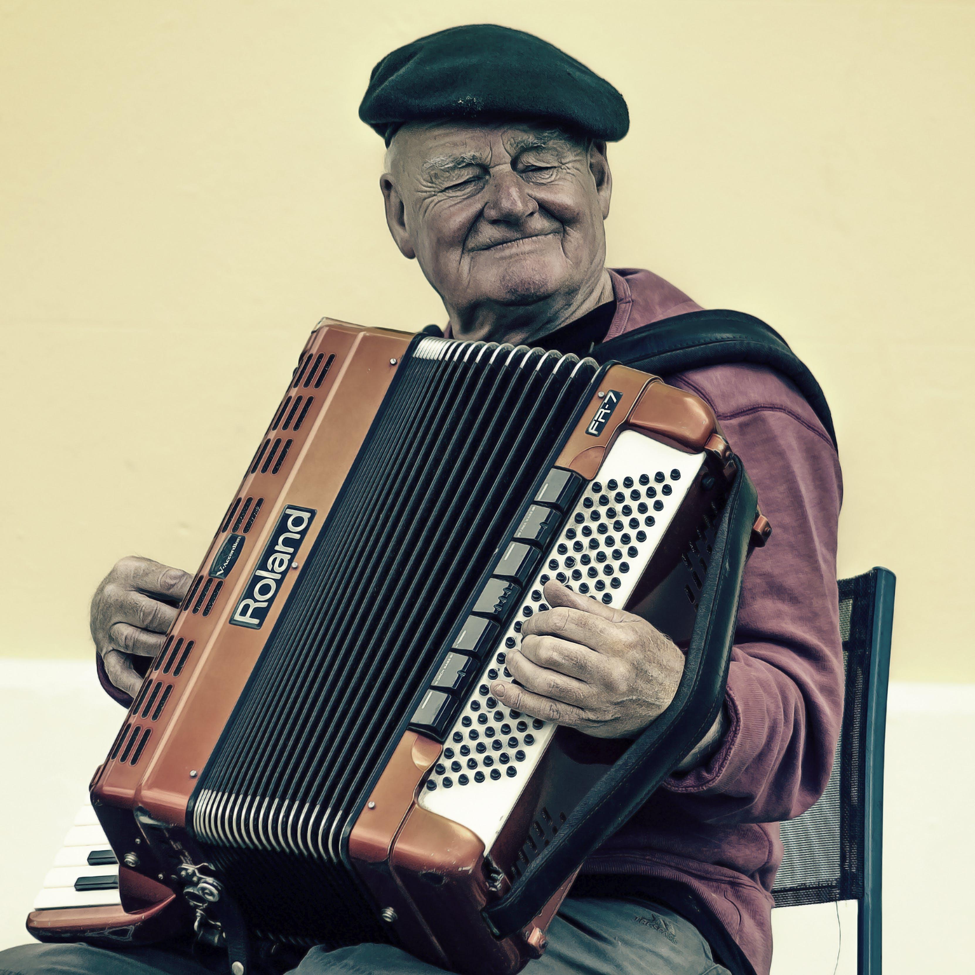 Man Sitting Playing Accordion