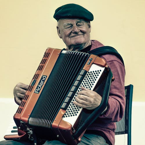 Man Sitting Playing Accordion