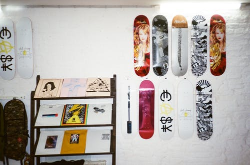 Assorted Skateboard Deck Hanging on Wall