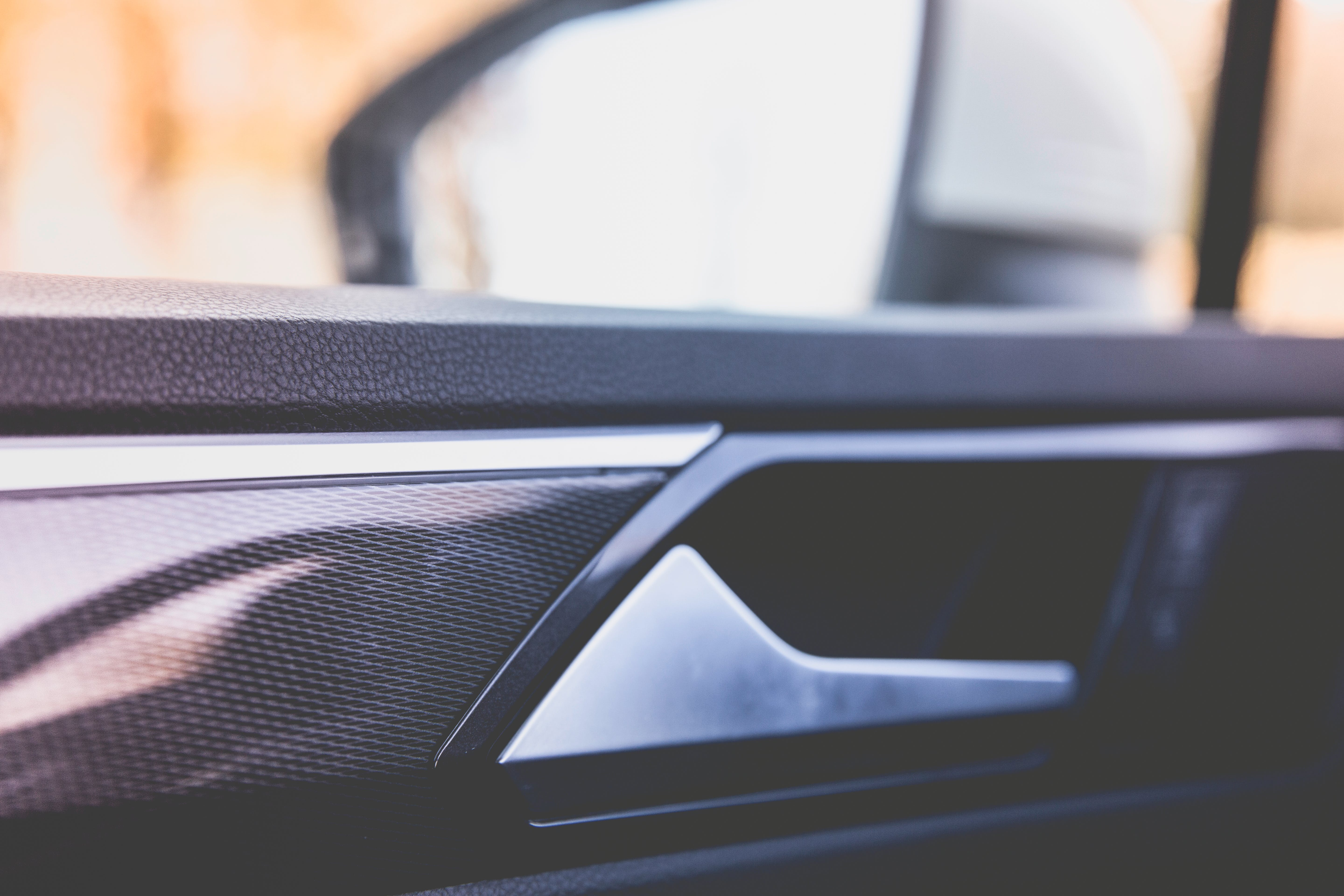 Close-up Photography of Black Vehicle Door Panel
