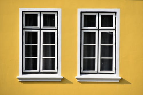 Closed White Wooden Framed Glass Windows