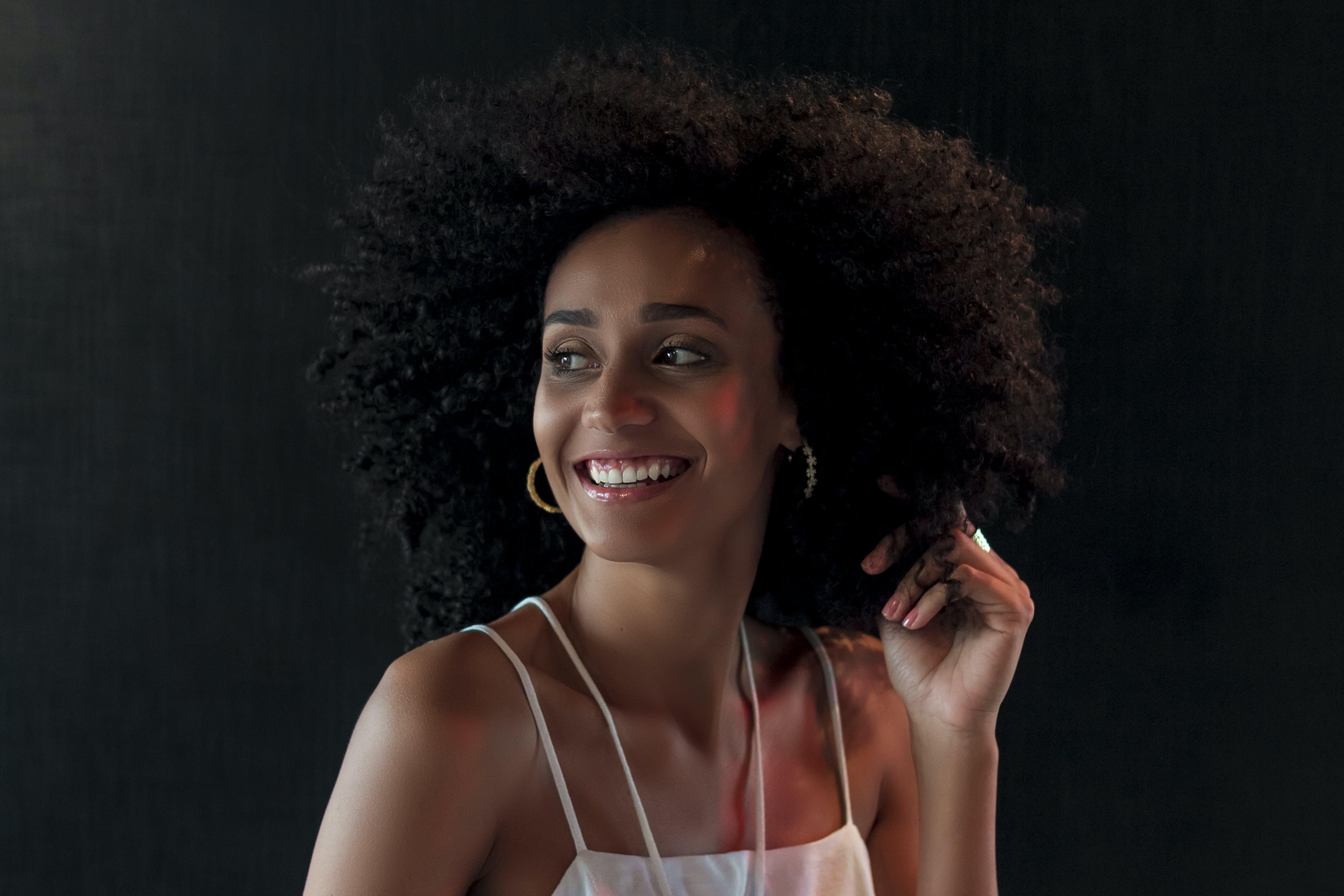 Smiling Woman in White Spaghetti Strap Top