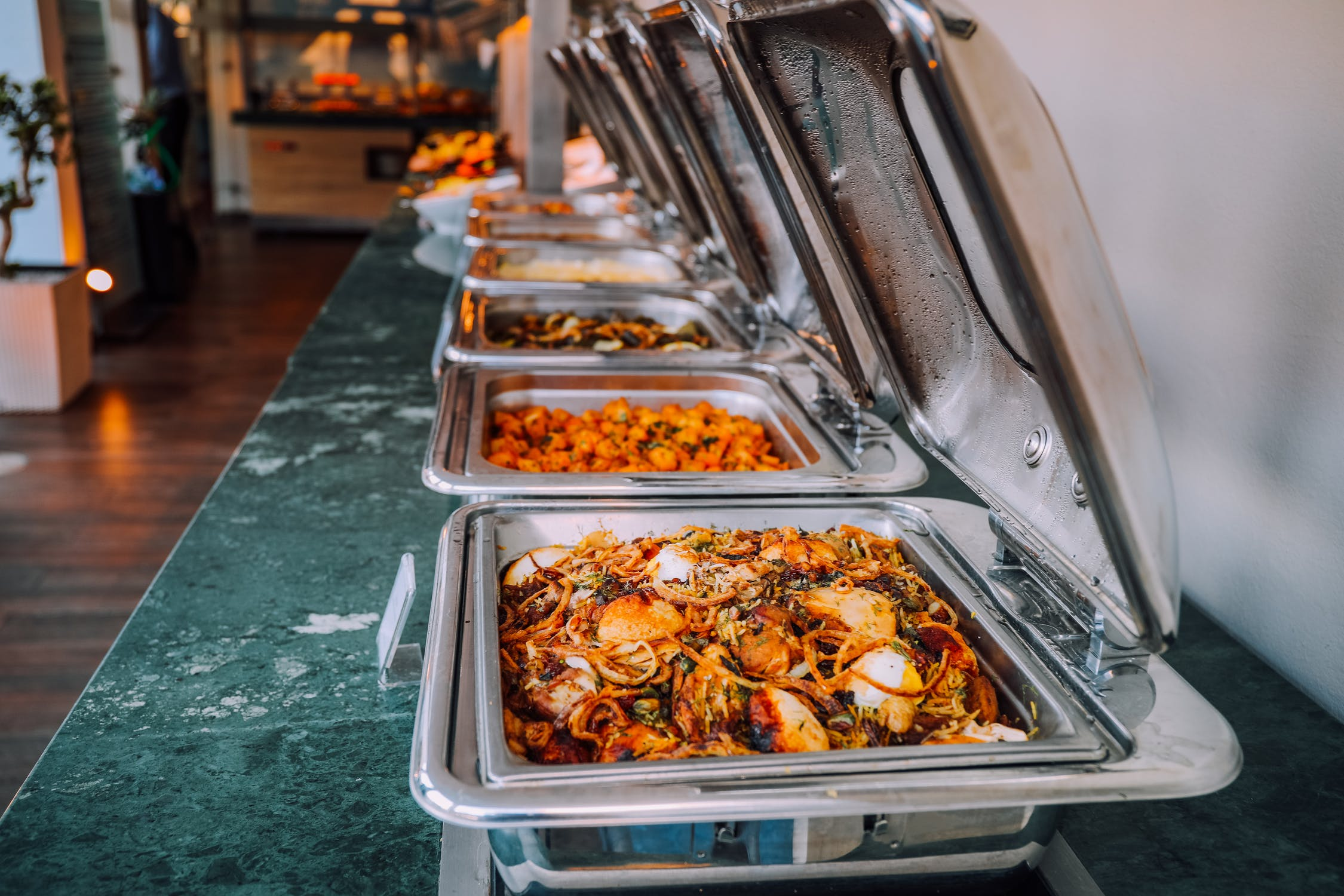 buffet trays full of savory food