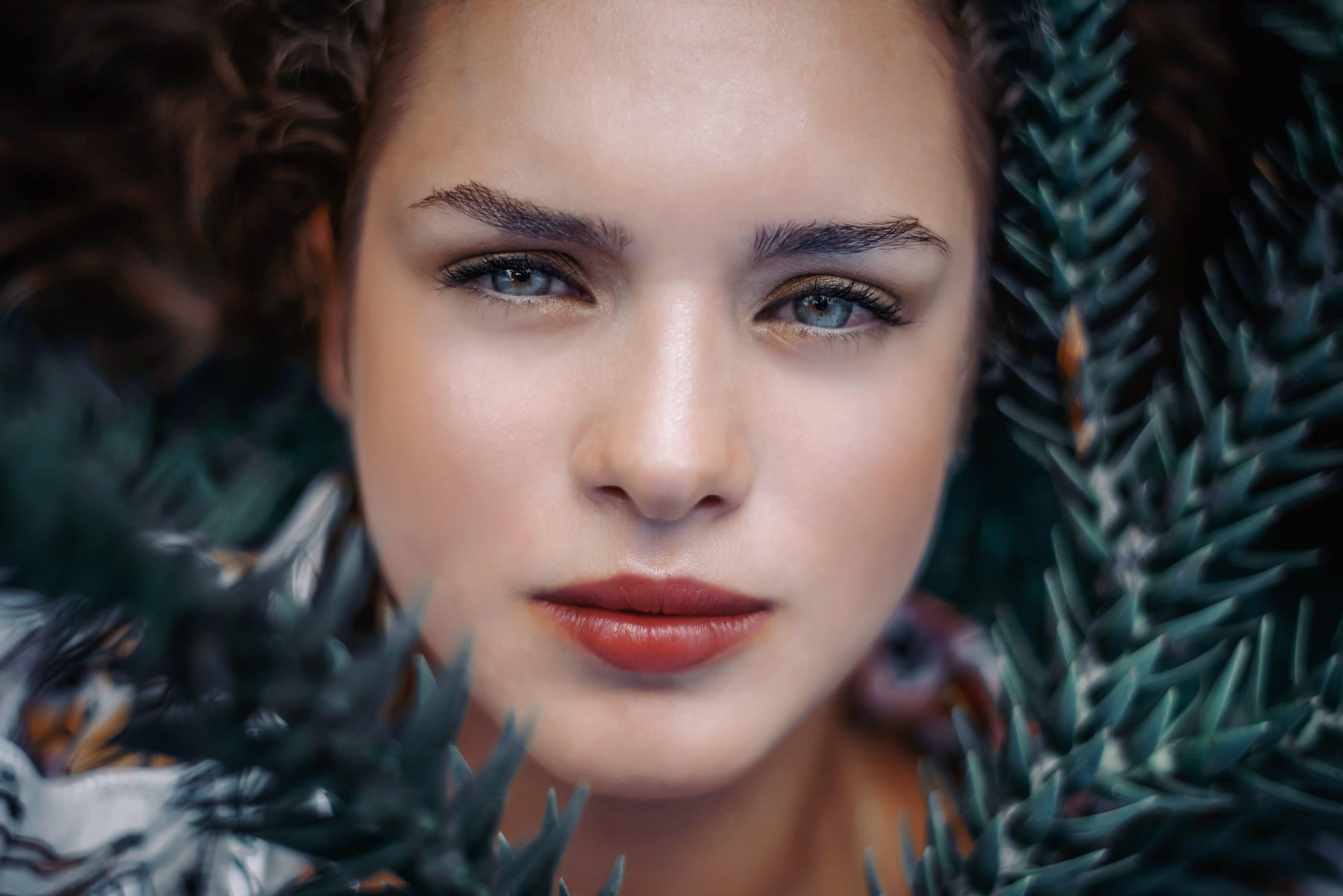 Woman's Face Beside Tree Leaf