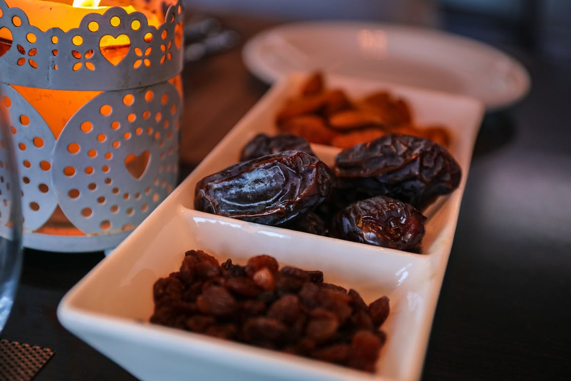 Close-Up Photo of Raisins and Dates