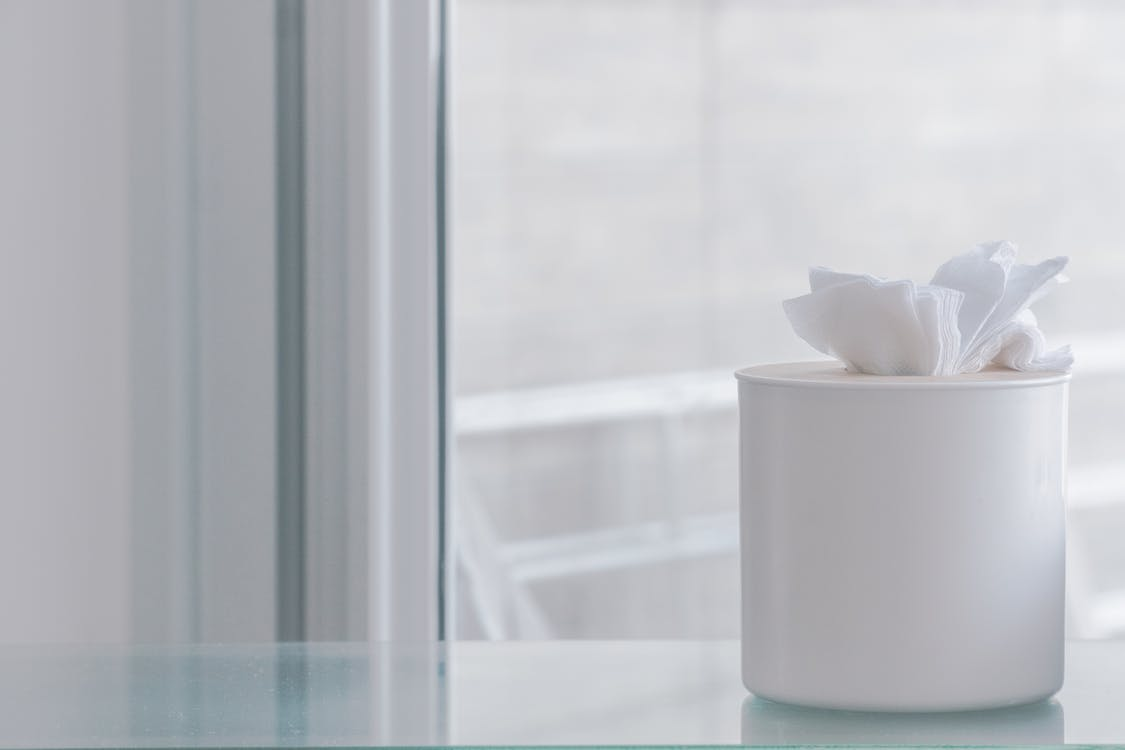 Tissue Paper on Container Near Glass Window