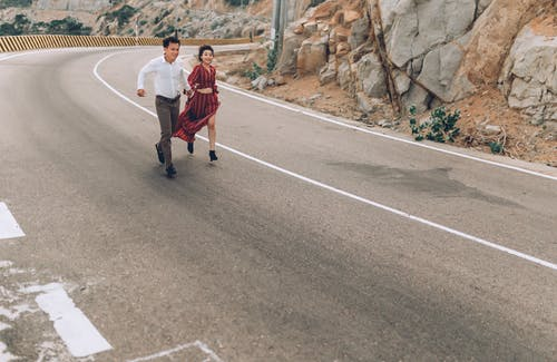Man and Woman Running in Highway