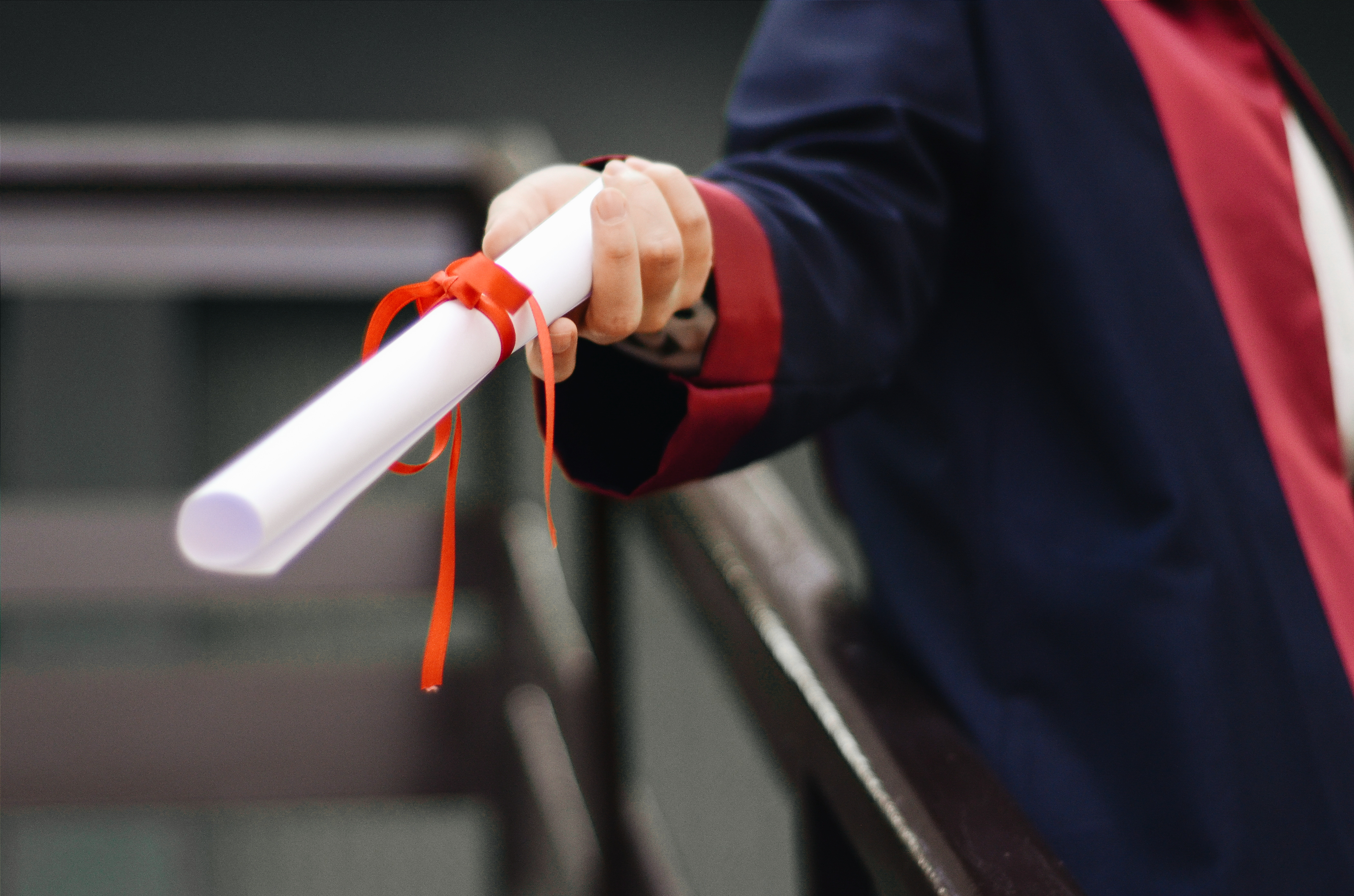 A person handing a rolled paper