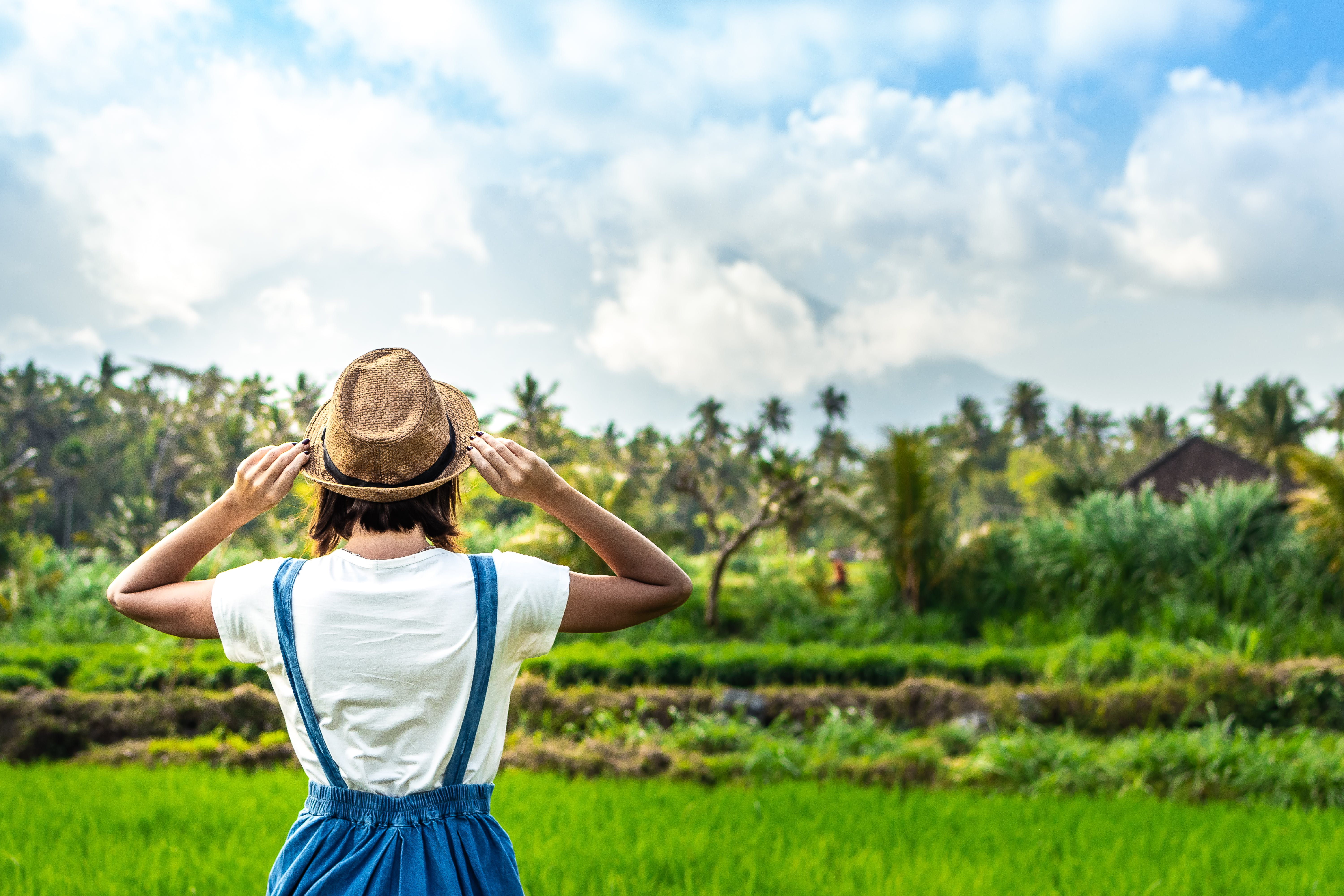 Woman Standing in Front of Green Field