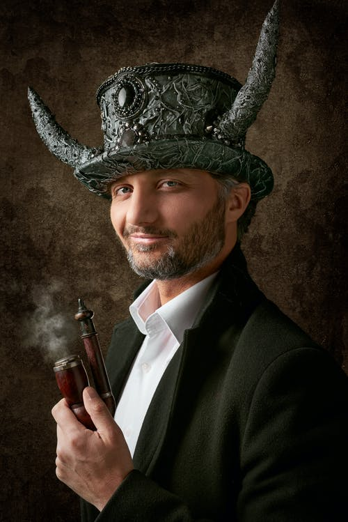 Man Smiling Wearing Hat with Horns