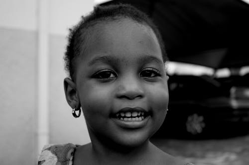 Close-Up Photo of Girl Smiling