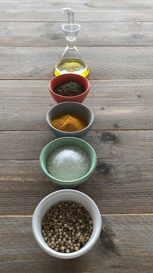 Gratis arkivbilde med karri, krydder, olivenolje, pepperkorn