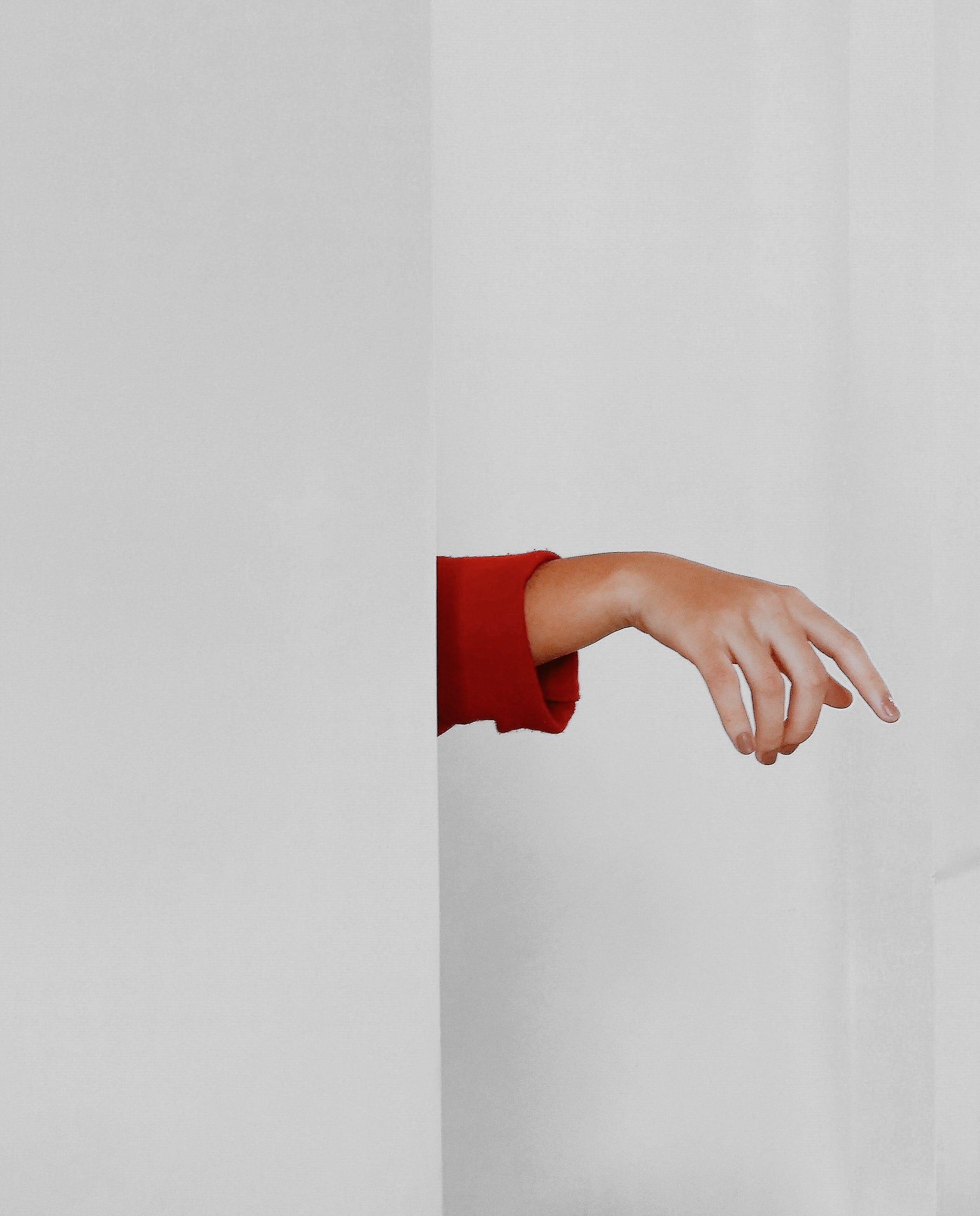 Right Human Hand Beside White Painted Wall