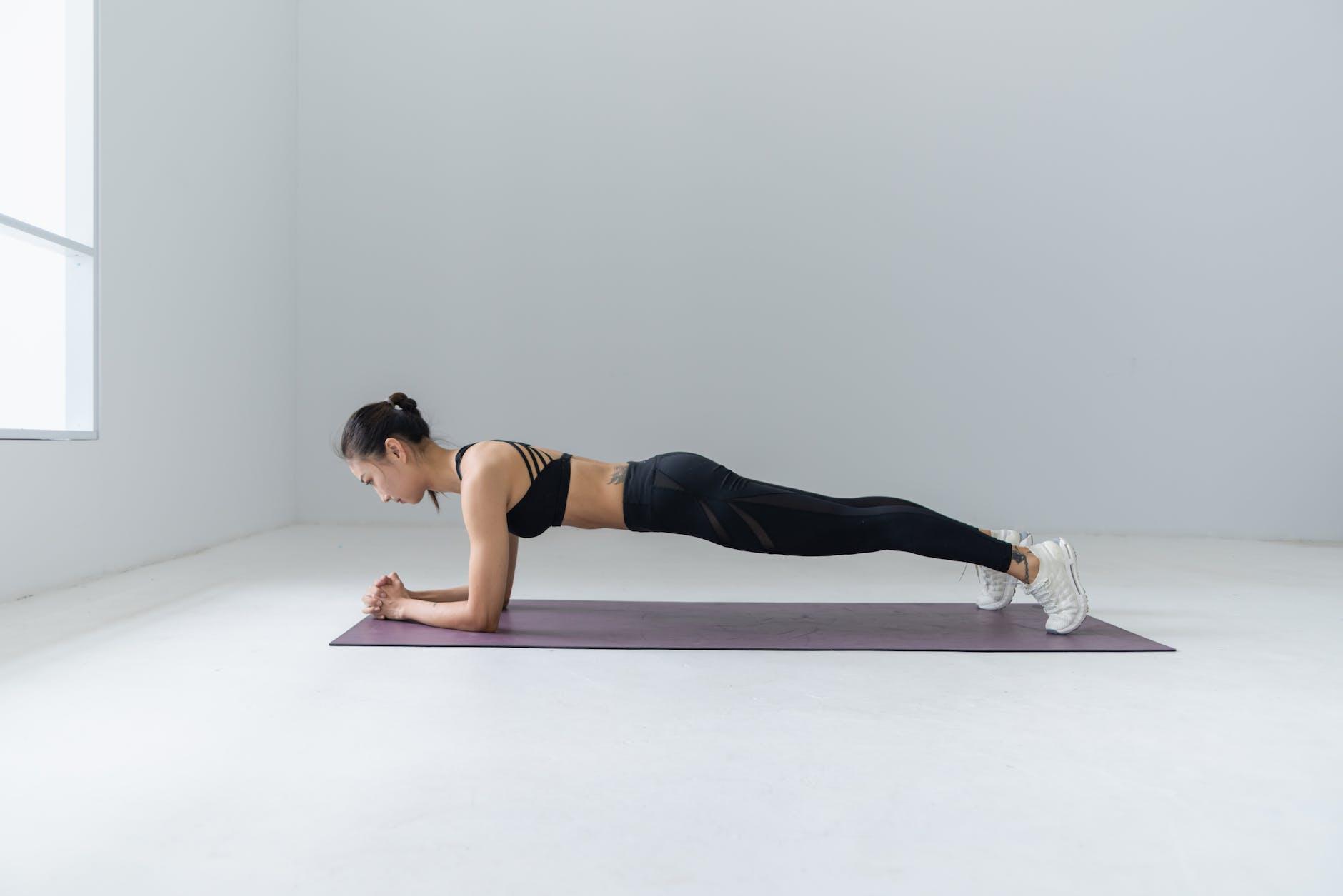 photo of woman doing yoga