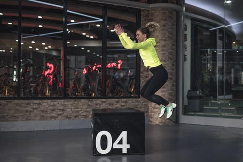 Photo of Woman Jumping on Box