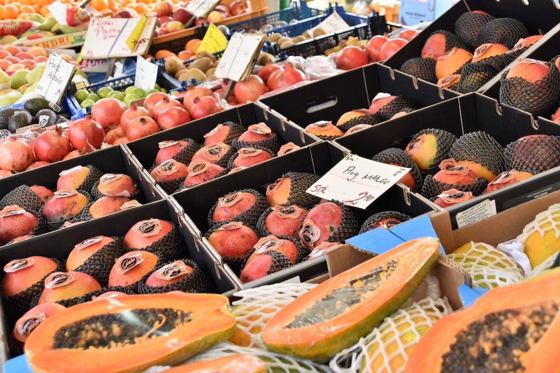 Assorted Fruits on Display Near Papaya Fruits