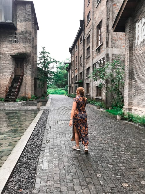 Woman Walking Near Structure