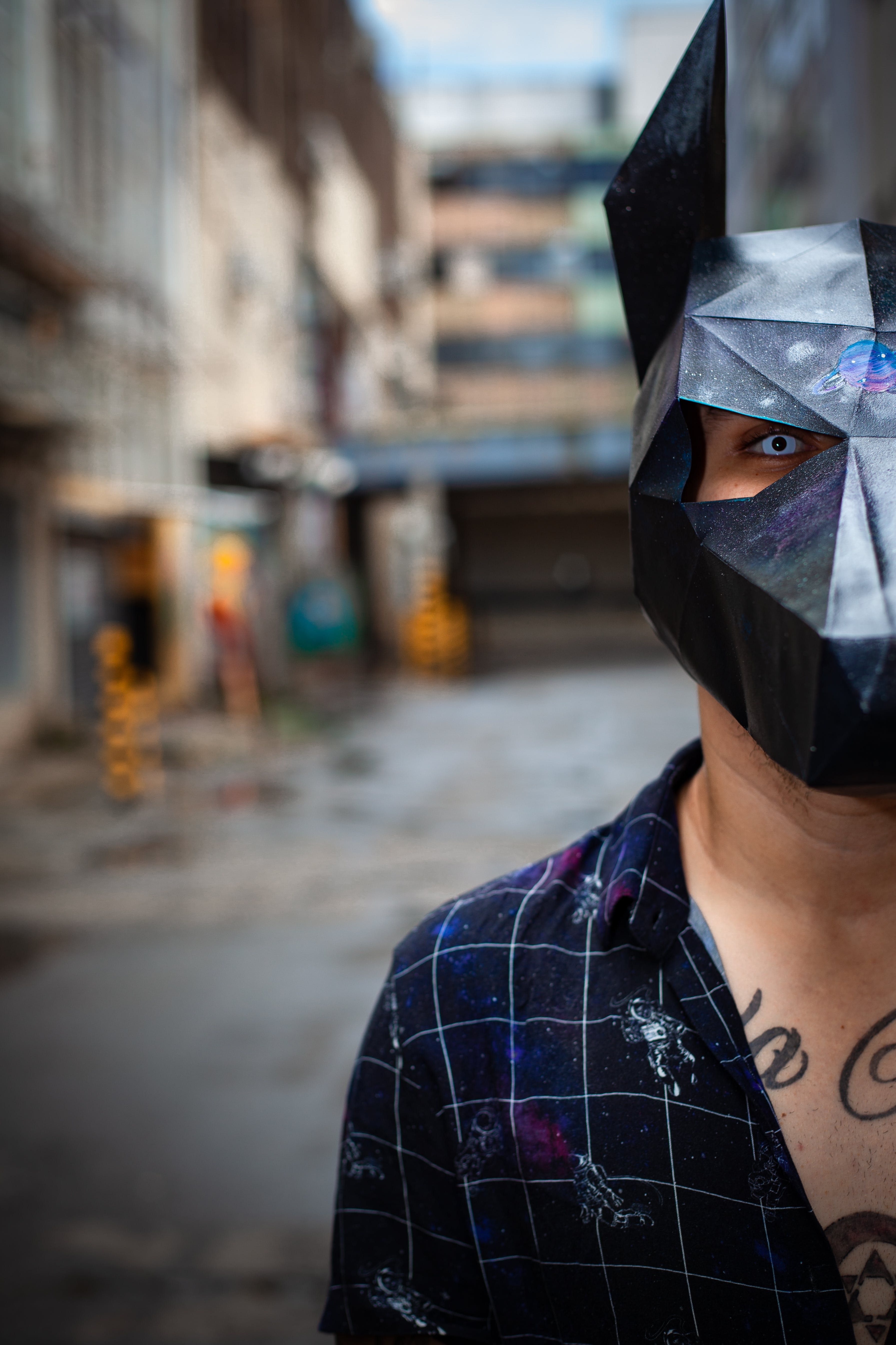 Man in Black and Gray Collared Top Wearing a Mask