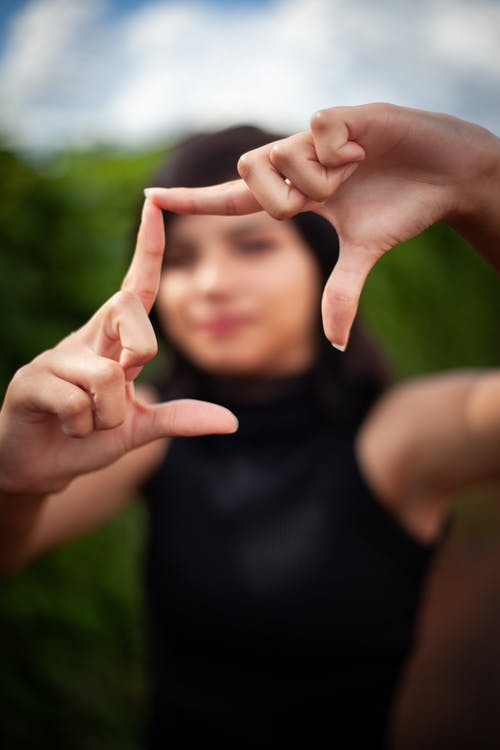Photo of Woman Doing Hand Sign