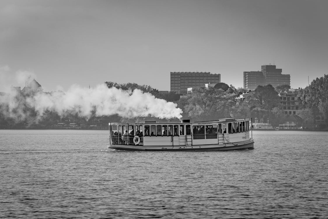 Grayscale Photography of Power Boat on Body of Water