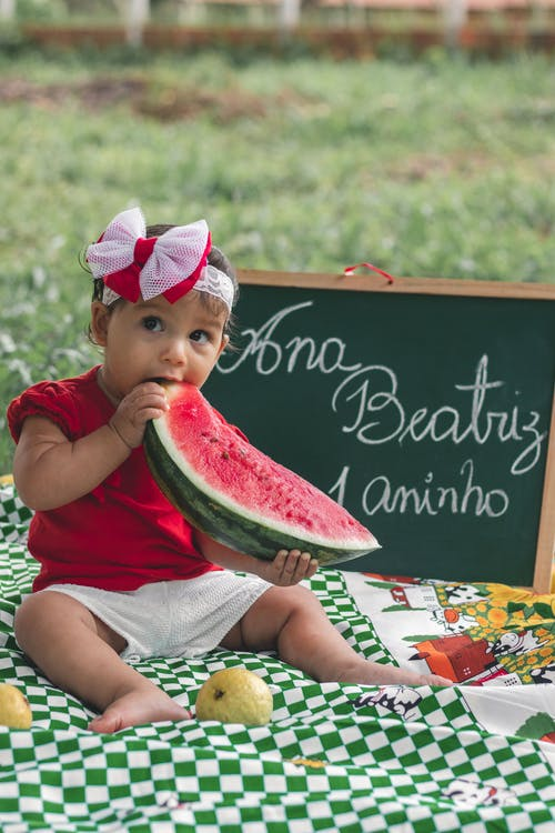 Photo of Girl Eating Watermelon