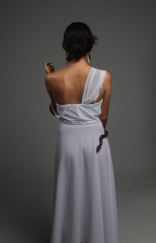Photo of Woman Wearing One-Shoulder Dress