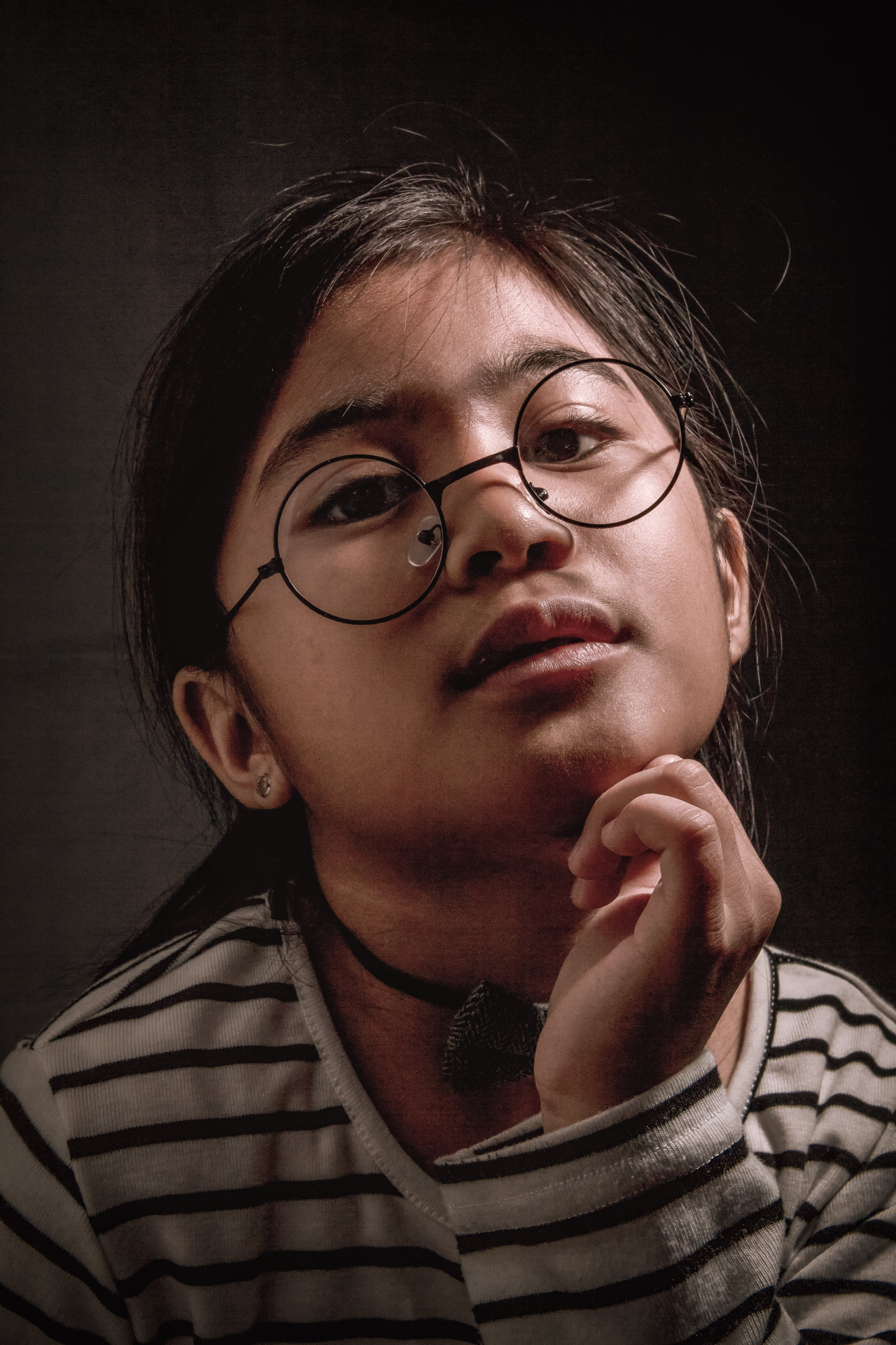 Portrait Photo of Girl in Black and White Striped Sweater With Black Framed Eyeglasses