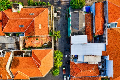 Bird's-eye View Photography of Two Orange RoofedHouses