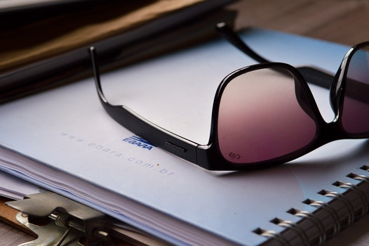 Free stock photo of sunglasses, notebook, table, eyewear