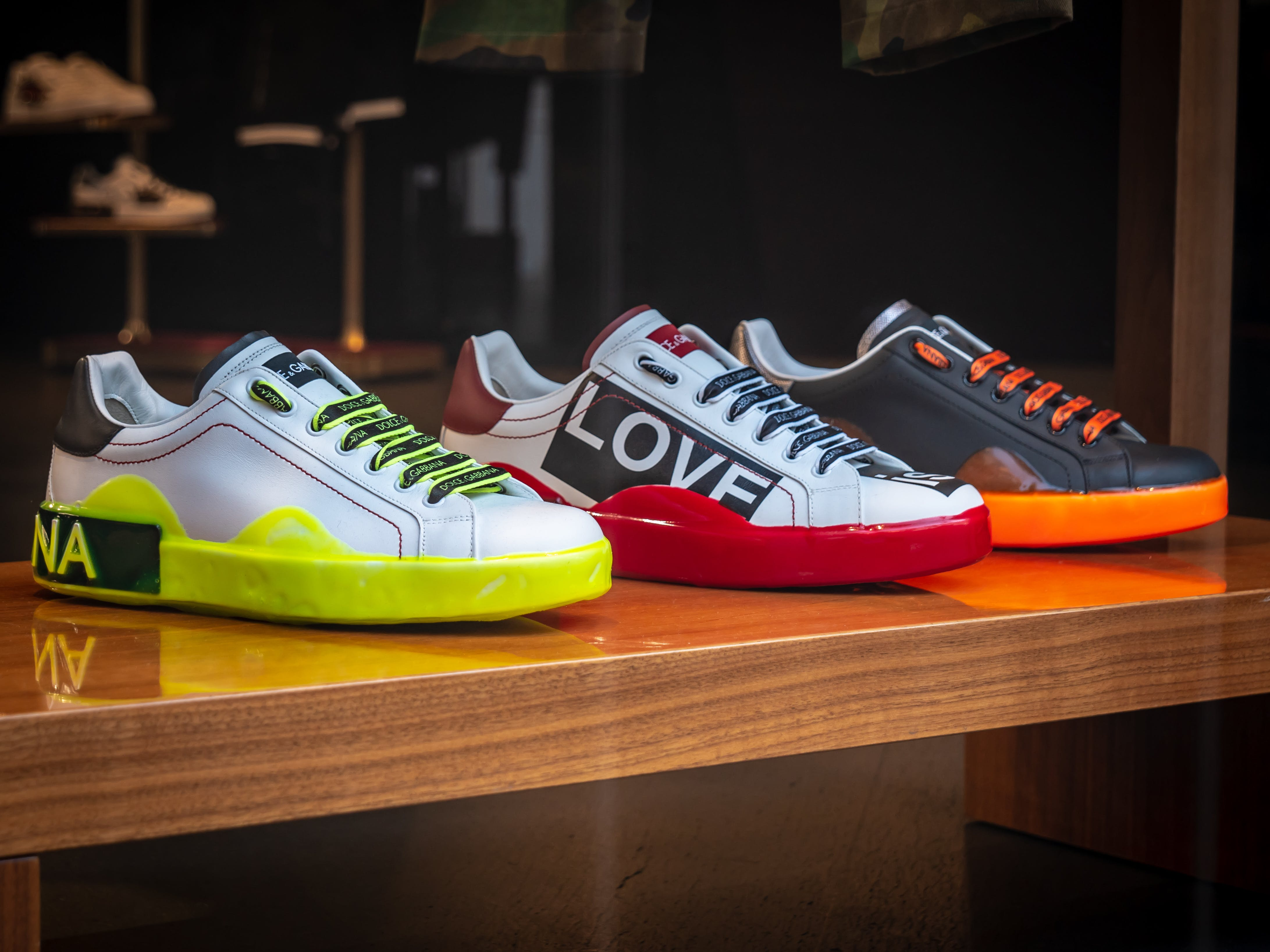 Three Unpaired Multicolored Leather Sneakers on Display
