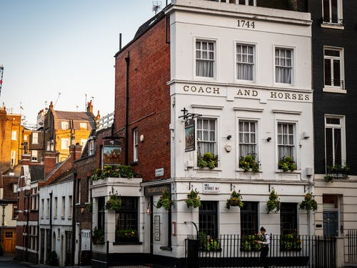 White and Brown Coach and Horses Concrete Building
