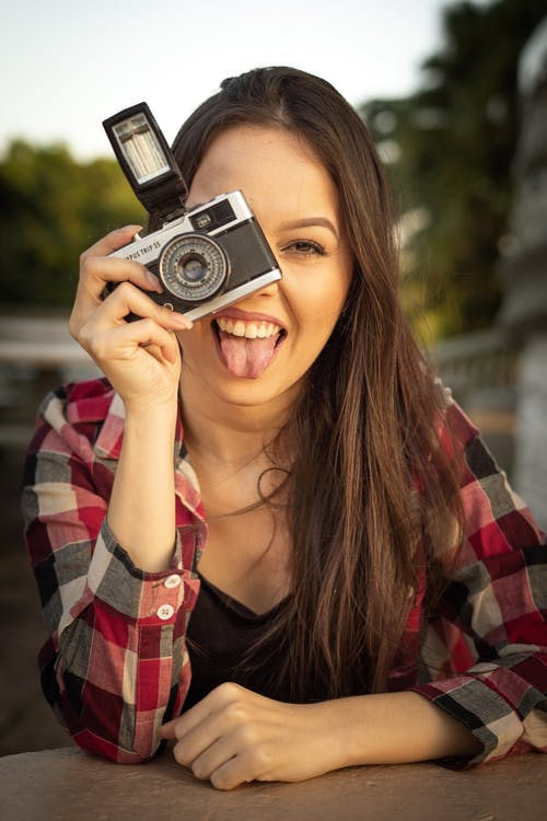 Portrait of Woman Holding Gray and Black Dslr Camera