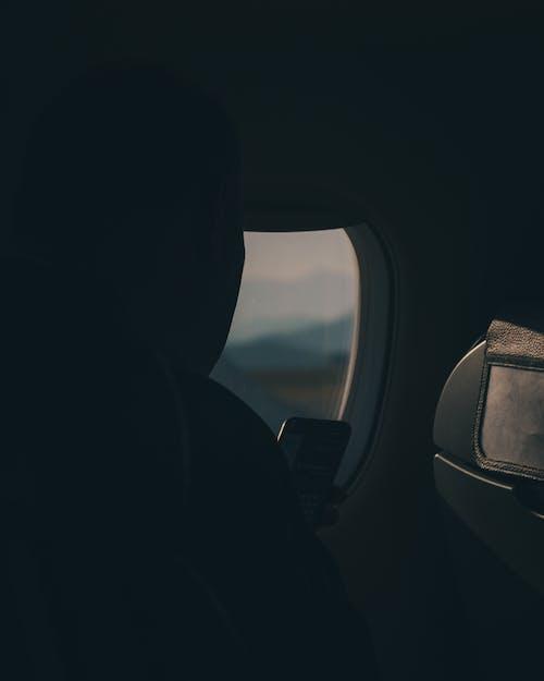 Gratis lagerfoto af fly vindue, flyrejse, flyselskab, flyvemaskine