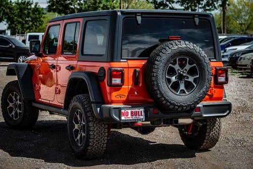Back View Photo of a Parked Red Jeep Wrangler Rubicon
