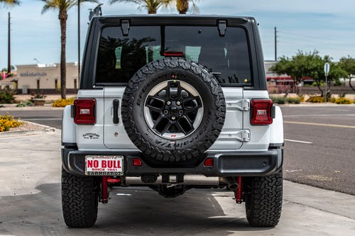 Back View Photo of a Parked White Jeep Wrangler Rubicon