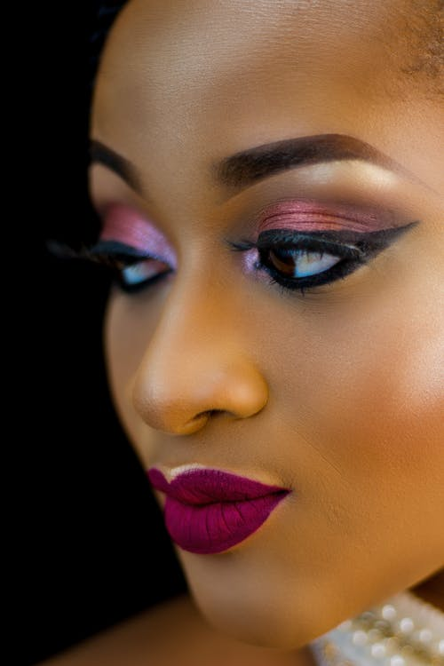 Close-up Photo of Beautiful Woman in Make-up Looking Away