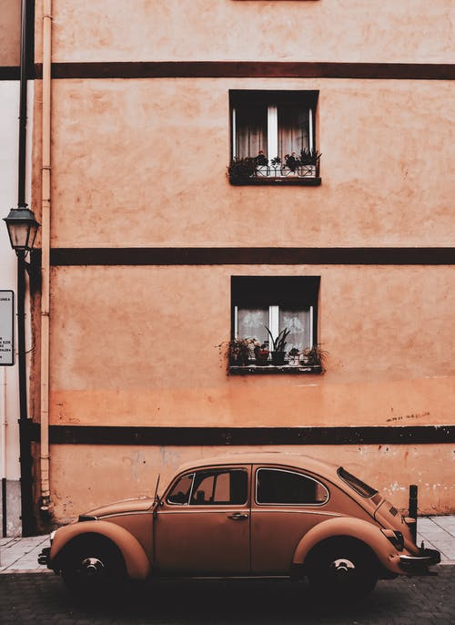 Beige Volkswagen Beetle Coupe Parked Near Concrete Building