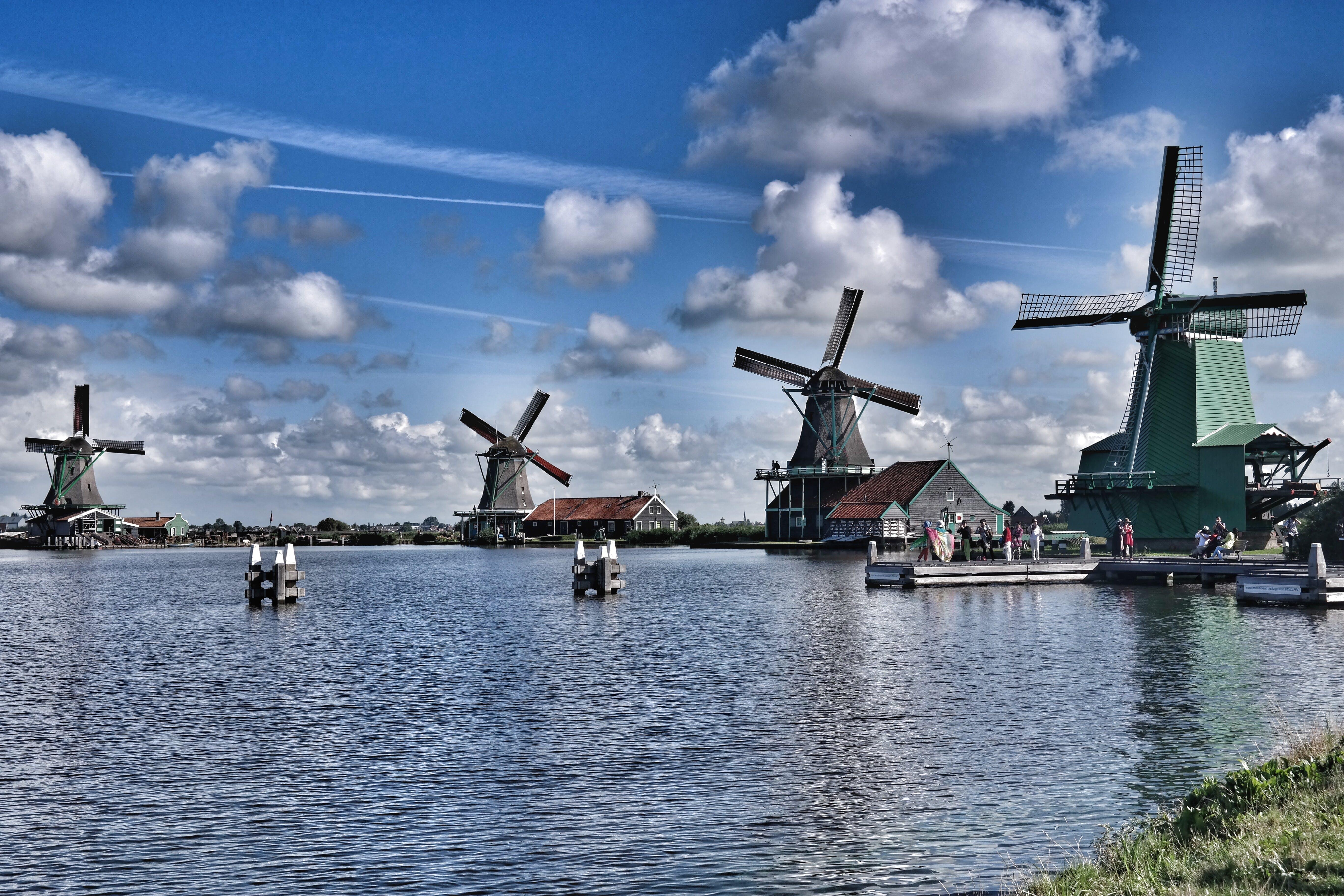 Wooden Windmills Near Lake