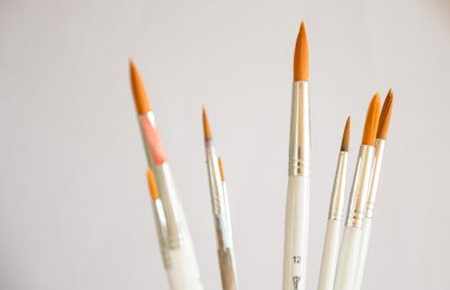 White and Orange Assorted Paintbrushes