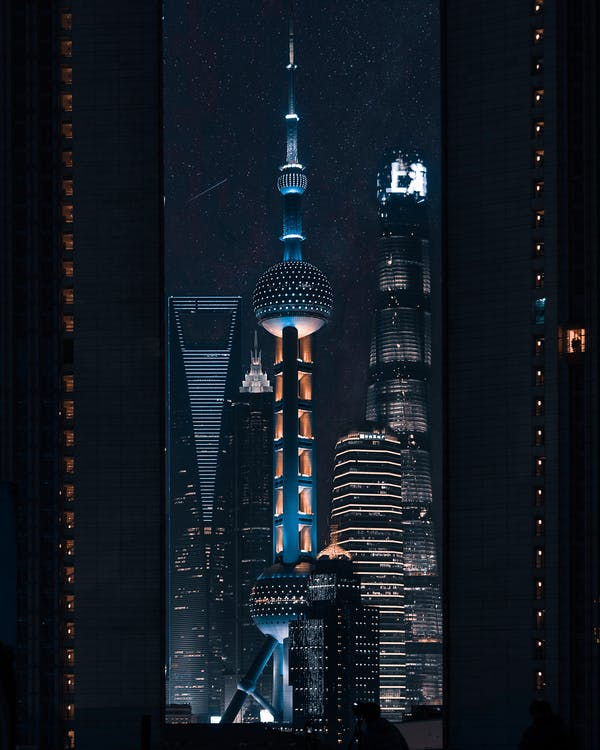 Lighted Tower Beside Building