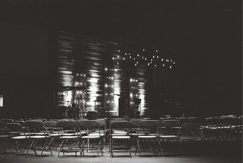 Grayscale Photography Of Chairs In An Auditorium