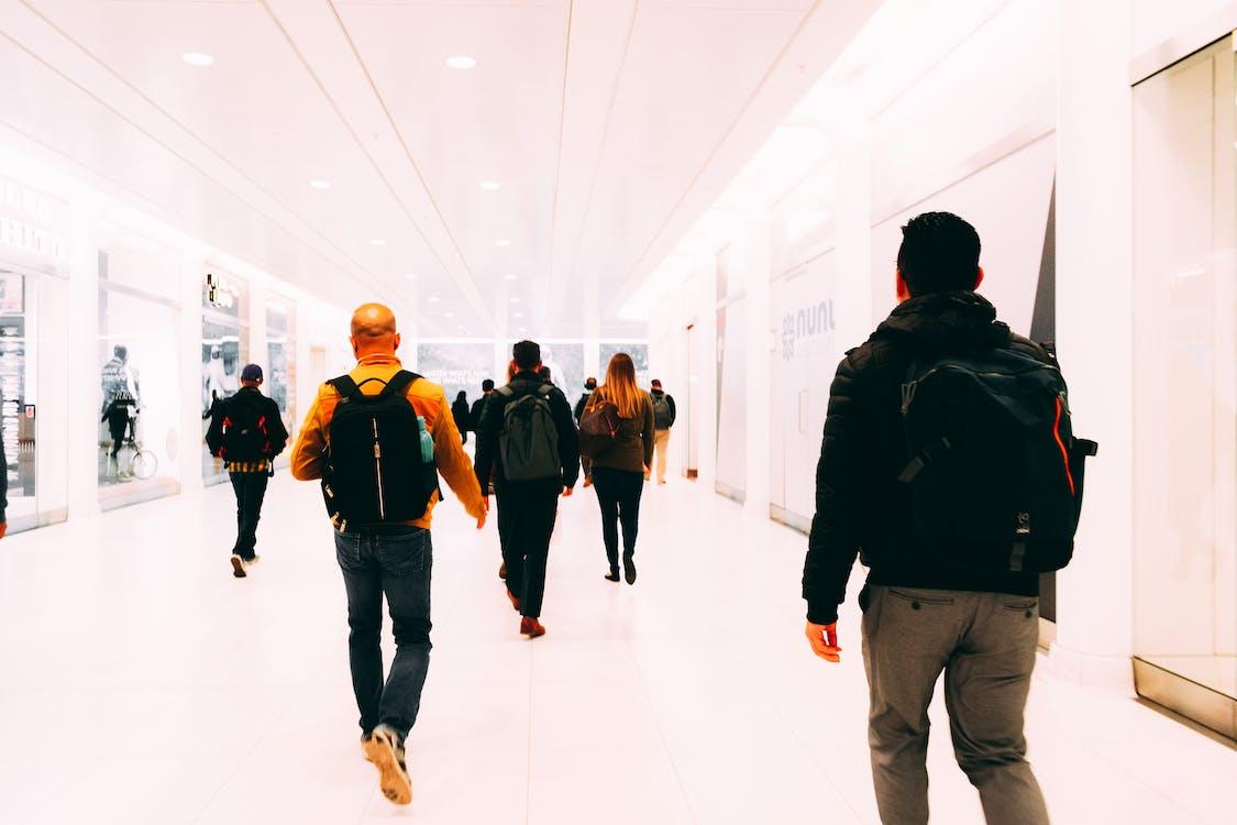 People Walking On A Hallway
