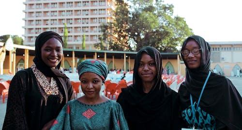 Photo of Four Women Wearing Turban