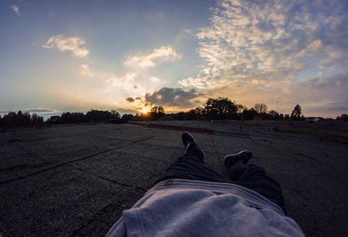 Free stock photo of boy, dynamic, evening sun, lay flat