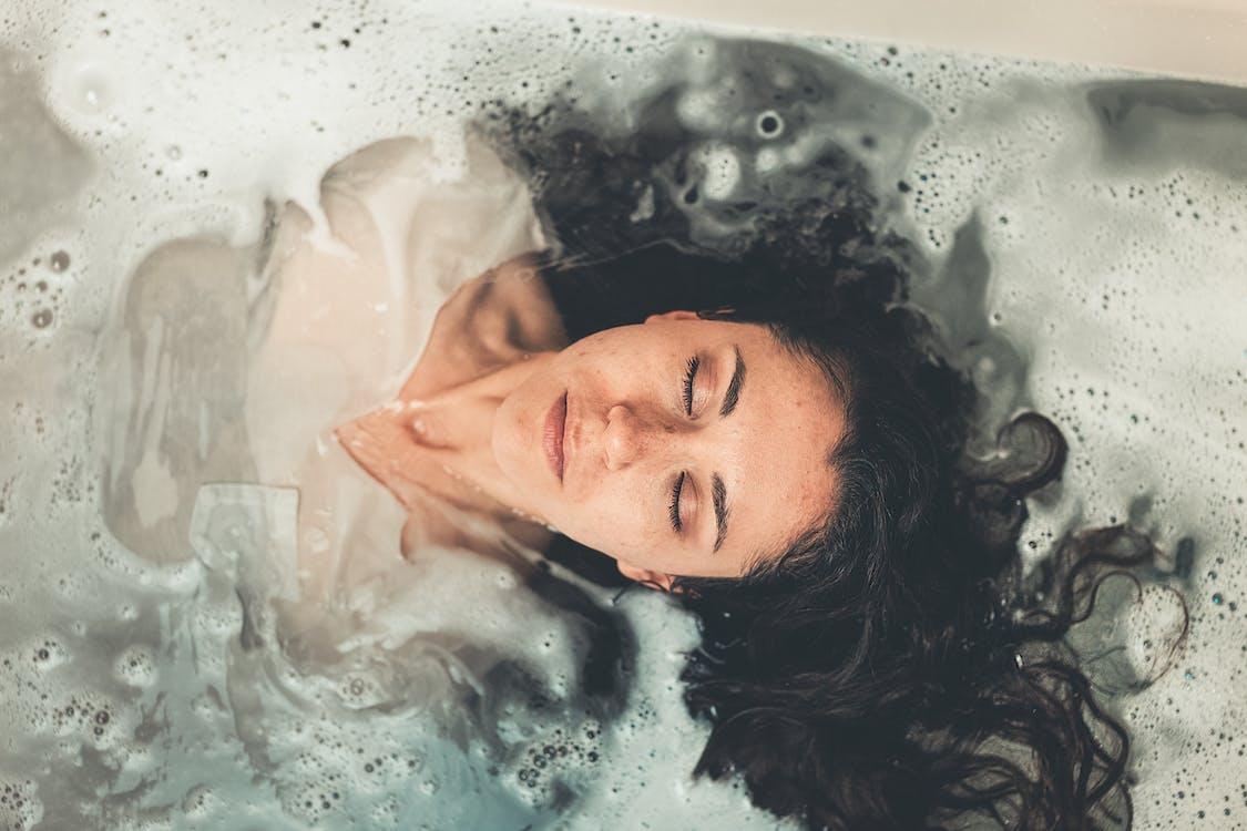 Woman in White Dress in Bath Tub