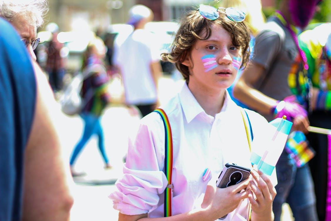 Boy Holding Smartphone and Flaglet
