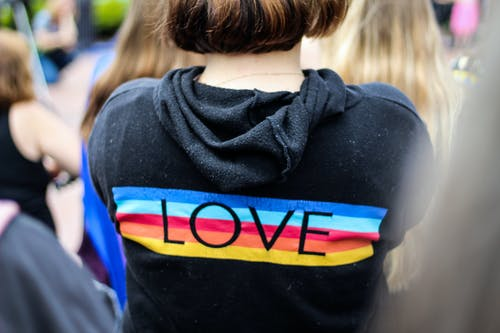 Woman in Black and Multicolored Love Print Hoodie