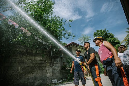 Firefighters Holding Hose